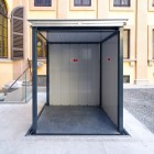 Hidden and concealed goods lift with retractable roof